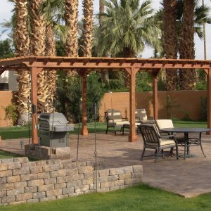 "Garden Pergola (Options: 26' L x 14' W, Redwood, No Electrical Wiring Trim, Open Roof with Slats at 12"", Rafters at 18"", Lengthwise Roof Support Timbers, 6-Post Anchor Kit for Stone, No Ceiling Fan Base, No Privacy Panels, No Curtain Rods, 9' Post Height, Transparent Premium Sealant). Photo Courtesy of Val Kay of Indian Wells, CA."