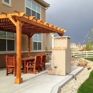 Garden Pergola (Options: 20' L x 12' W, Mature Redwood, No Electrical Wiring Trim, Lattice Roof, Lengthwise Roof Support Timbers, 4-Post Anchor Kit for Stone, No Ceiling Fan Base, No Privacy Panels, No Curtain Rods, 9.5' Post Height, Transparent Premium Sealant).