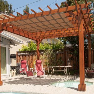 "Garden Pergola (Options: 14' L x 14' W, Redwood, No Electrical Wiring Trim, Open Roof with Slats at 12"", Rafters at 18"", 4-Post Anchor Kit for Stone, No Ceiling Fan Base, No Privacy Panels, No Curtain Rods, 9' Post Height, Transparent Premium Sealant). Shade cloth added by customer after installation."