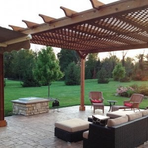 Garden Pergola (Options: 20' L x 16' W, Mature Redwood, No Electrical Wiring Trim, Lattice Roof, Lengthwise Roof Support Timbers, 4-Post Kit for Stone, Brick, or Concrete, No Ceiling Fan Base, No Privacy Panels, No Curtain Rods, 10' Post Height, Transparent Premium Sealant). Photo Courtesy of David Wilson.