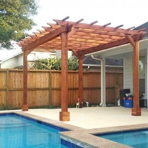"Garden Pergola (Options: 15' L x 11' W, Redwood, No Electrical Wiring Trims, Open Roof with Slats at 18"", Rafters at 18"", 4-Post Anchor Kit for Concrete, No Ceiling Fan Base, No Privacy Panels, No Curtain Rods, Transparent Premium Sealant). Photo Courtesy of T. Mullin of Katy, TX."