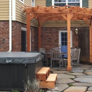 "Spa Steps (Options: 48"" x 22"" x 18H"", Redwood, No Engraving, Transparent Premium Sealant). Photo Shows Custom Pergola in Background. Photo courtesy of Deborah Pasik of Morrisontown, New Jersey."